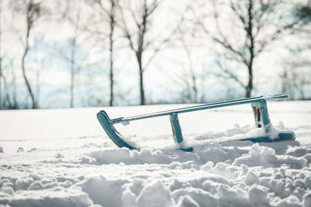 Blue sleigh or sledge on deep snow, winter holidays and vacation with sledging and sledding
