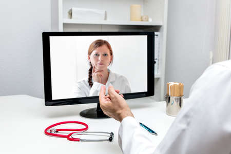 two doctors are having a videoconference, concepts like telemedicine or covid Stock fotó
