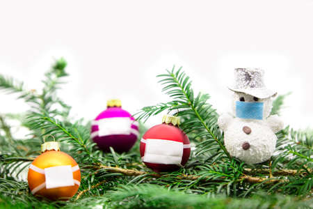 Christmas decoration in front of white background, medical face mask, concept corona virus, covid-19 Stock fotó