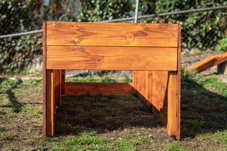 A raised bed made of wood planks is built in the garden Stock fotó