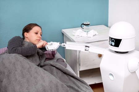 Medicine robot is helping a female patient, working as caregiver, giving a handkerchief