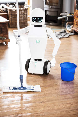 automatic robot floor scrubber is doing his work in an living room, vertical shot with copyspace