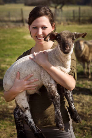 Woman holding a lamb, concept vegan and vegetarian life