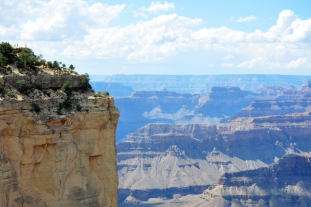 the height of a rim: Extraordinary view of the Grand Canyon and its surrounding cliff, where bystander look very small, Arizona, USA