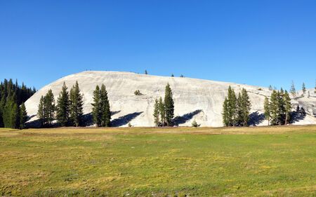 monolith: Huge monolith is making a small hill, Yosemite National Park eastern entrance, California, USA Stock Photo