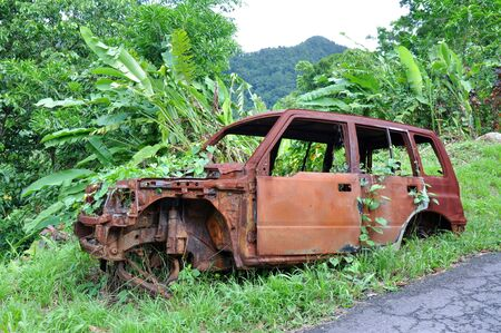 commonwealth: Carcass of an old car, Commonwealth of Dominica Stock Photo