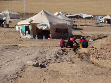war refugee: Children playing with water in Gawilah  gawilan  camp, near Bardarash, Kurdistan, Iraq