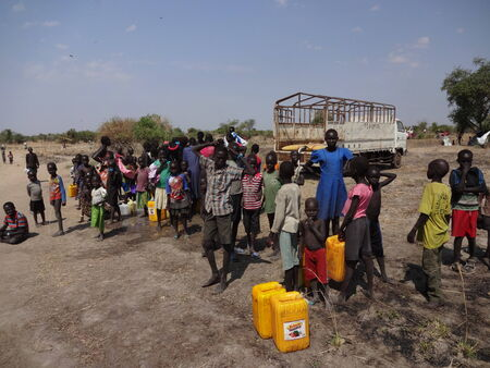 People and families gathering near a water truck to collect drinking water, Mingkama  mingkaman , Awerial, Lakes State, South Sudan