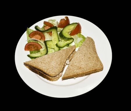 sandwitch: tuna sandwitch on brown bread with salad garnish Stock Photo
