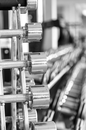 iron dumbbells in two rows Standard-Bild