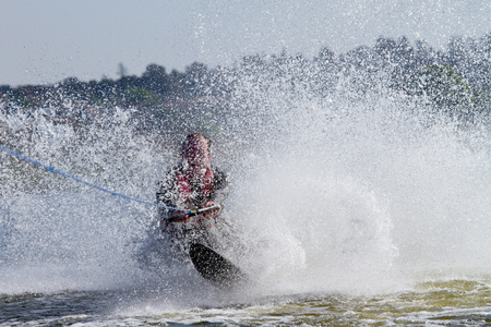 water skier: Amateur skier falling and splashing lots of water