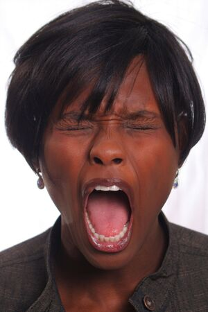 eyes wide: Woman screaming Stock Photo
