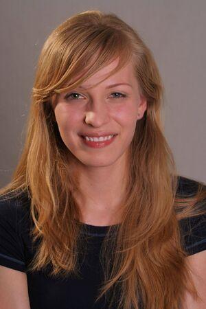 girl smiling into camera Banco de Imagens