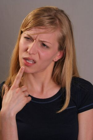 stupid: confussed woman Stock Photo