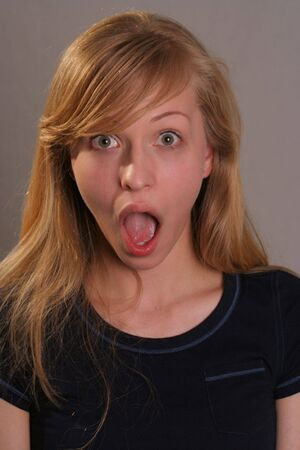 woman mouth open: woman with surprised expression