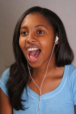 Girl singing with headset Banco de Imagens