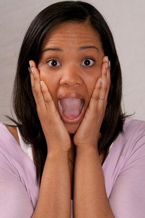 Woman screaming with hands on face photo