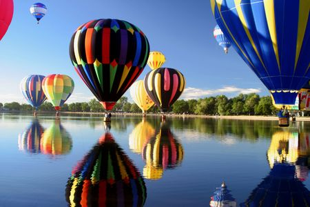 hot spring: Hot Air Ballooning Lake Reflection Stock Photo