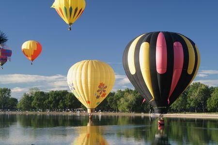 Hot Air Ballooning Lake Reflection Stock Photo