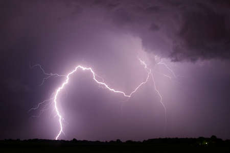 rain weather: lightning arc across sky thunderstorm Stock Photo