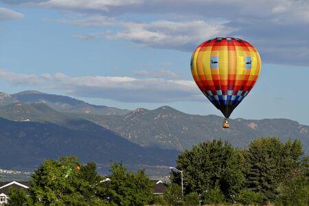 hot air balloon flight in mountains Stock Photo