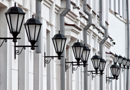 street lights: Street lights on the facade of the old building in Arkhangelsk