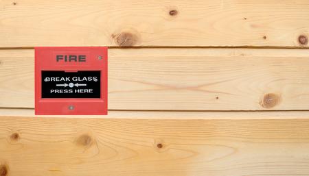 escape key: fire break glass on the wood wall Stock Photo
