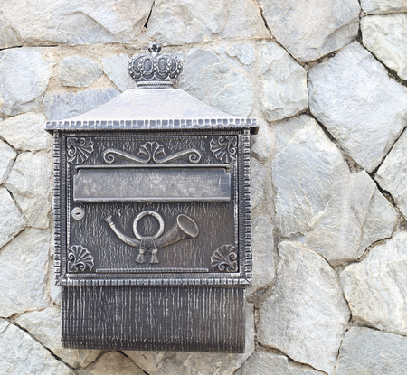 mail slot: Old postbox on stone wall Stock Photo