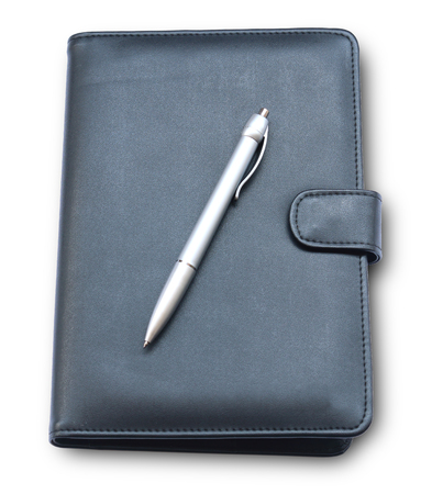 diary cover: Pen put on diary cover isolate on white background