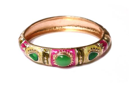 bangle: Gold bangle with green stones on the white background