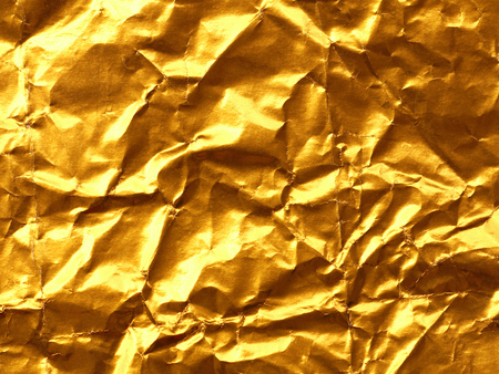 gold textured background: Gold Paper creased and folded to provide a textured background