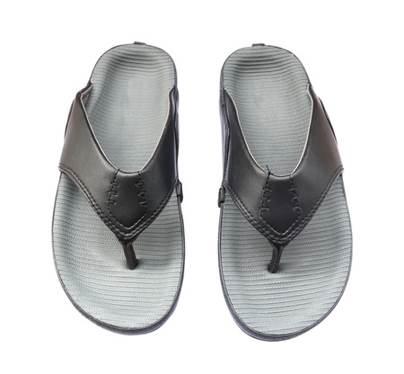 grays: Pair of grays and black leather sandals isolated on a white background Stock Photo