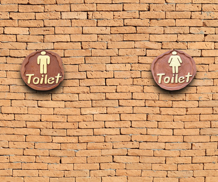 brick sign: Toilet sign on the brick wall