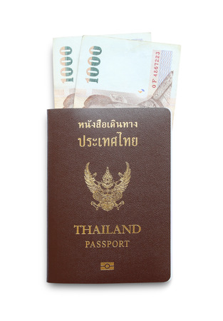 customs official: Thailand passport and thailand money 1000 baht isolated on white background. Stock Photo