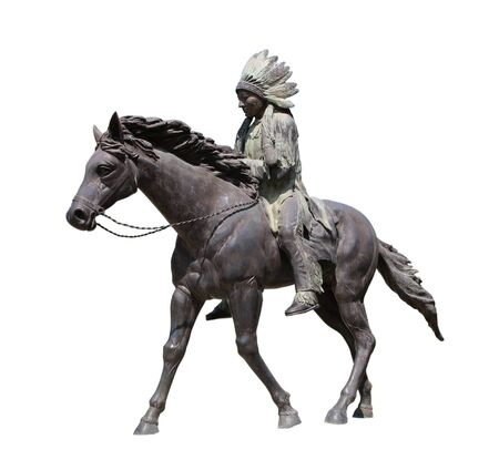 Statue of A Red indian or native American that riding a horse isolated on whit Stock Photo