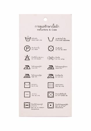 textile care: Laundry symbol label, thai and english language version isolated on white background