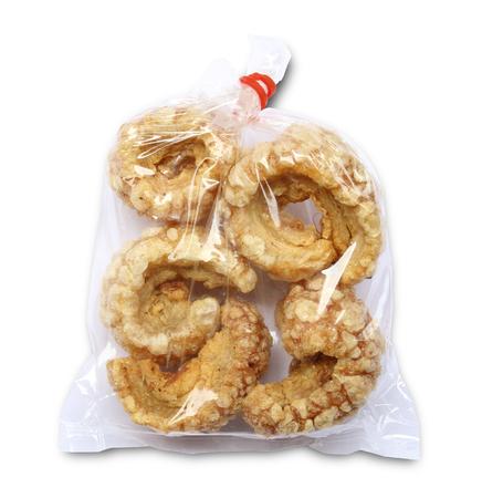 crackling: Crispy skin pork in plastic bag on white background