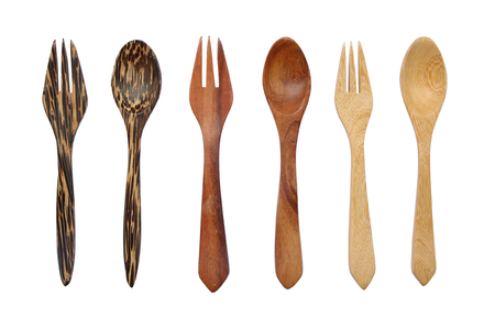 Kitchenware set of wooden spoon and fork isolated on white background.