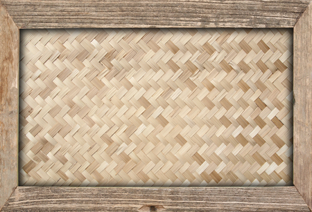Woven bamboo pattern in wooden frame