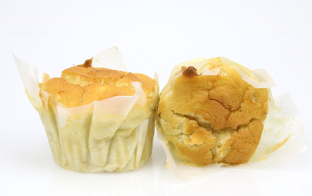 Muffin cakes on white background.
