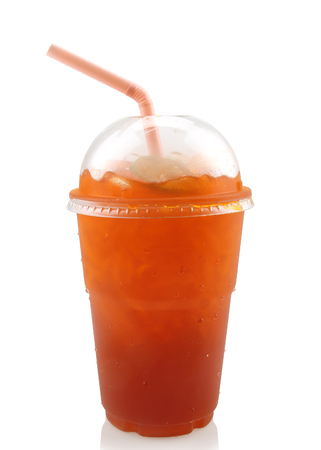 Lemon iced tea in plastic glass with straw isolated on white background.