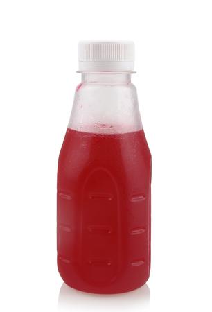Bottled fruit juice isolated on white background.