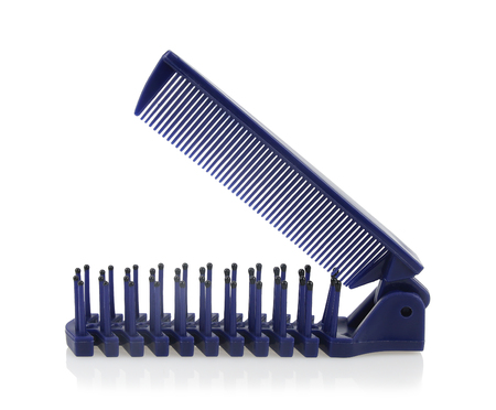 Blue dual purpose folding comb made by plastic isolated on white background.