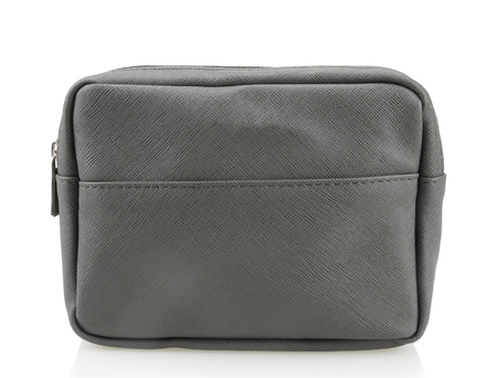 Gray leather makeup bag isolated on white background.