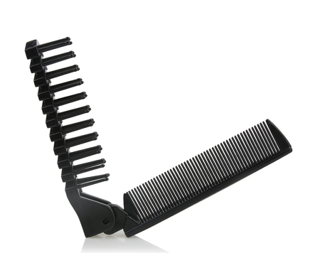 Black dual purpose folding comb made by plastic isolated on white background.