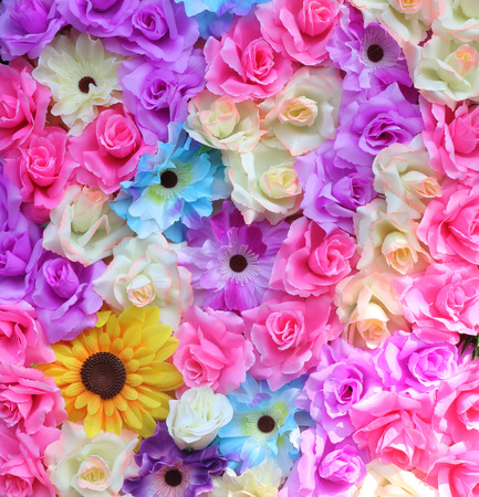 Colorful of plastic flowers for background. Archivio Fotografico