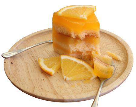 Orange cake with orange slice in wooden dish isolated on white background. 스톡 콘텐츠