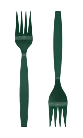 Green plastic fork isolated on white background.