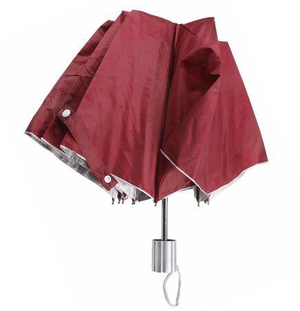 Folding umbrella isolated on white background.