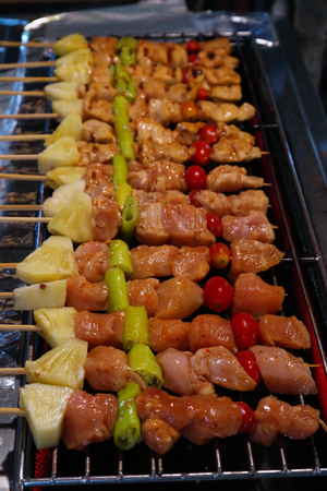 Close up to barbecue on skewers in grill stove.BBQ Street food in Thailand Banque d'images